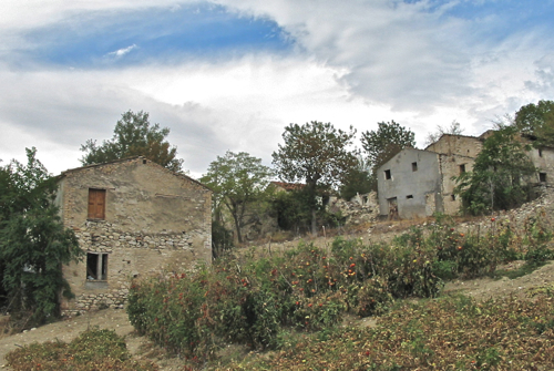 Then. On the left - the barn that became our villas. On the right - the ruin we demolished to build our house